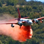 Firefighters watching a P2V drop long term retardant on the White Fire
